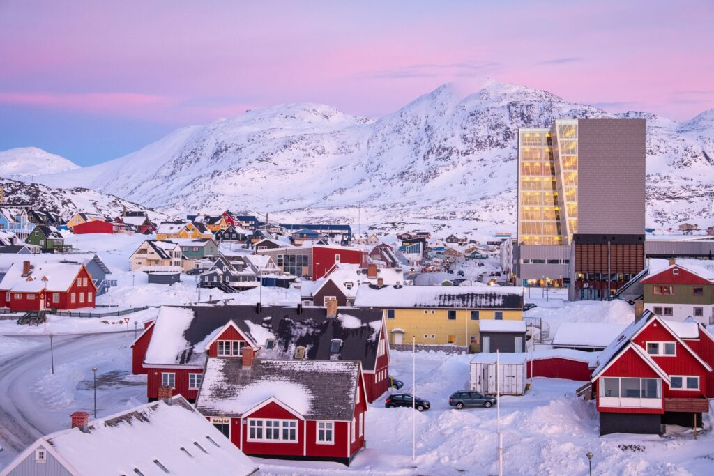 Downtown Nuuk at sunset with pink skies and the mountain - Store Malene - in the background