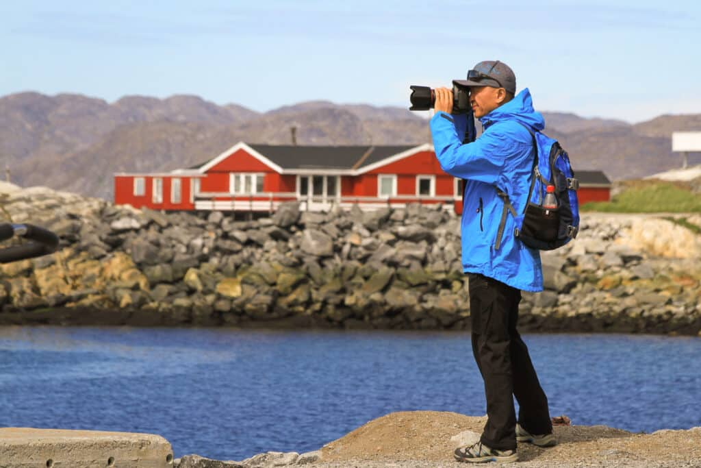 Person taking a photo from the Colonial Harbour in Nuuk - Greenland