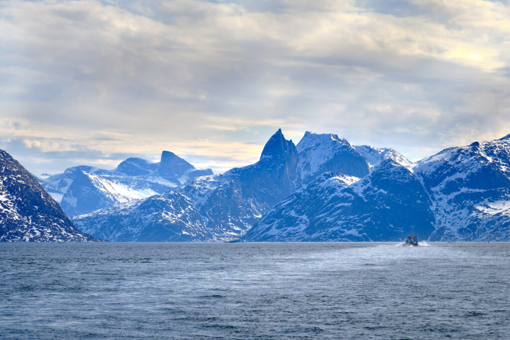 Following another boat into the Nuuk fjord on a boat tour with Guide to Greenland