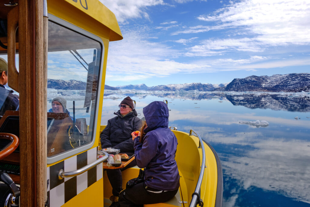 Having lunch in the front of the boat on a tour to the Nuuk Icefjord with Guide to Greenland