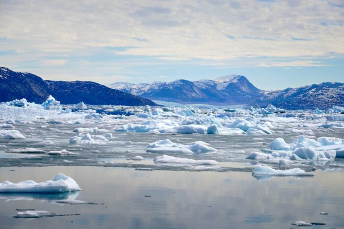 Ice and a massive glacier near the start of the Nuuk Icefjord on a boat tour with Guide to Greenland