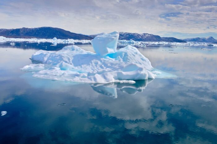 Iceberg reflected and visible beneath the water the Nuuk Icefjord on a boat tour with Guide to Greenland