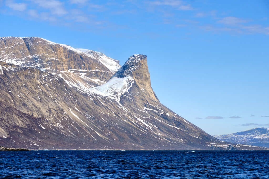 Impressive shapes of the mountains of the Nuuk fjord on a boat tour to Kapisillit with Guide to Greenland