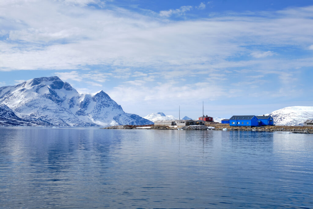 Passing the old Qoornoq fish factory on a boat tour up the Nuuk Fjord with Guide to Greenland