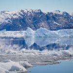 Reflections in the water the Nuuk Icefjord on a boat tour with Guide to Greenland