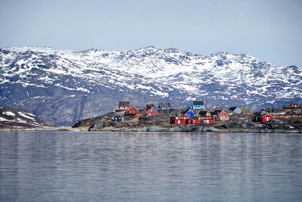 The colourful houses of Qoornoq on a boat tour up the Nuuk Fjord with Guide to Greenland