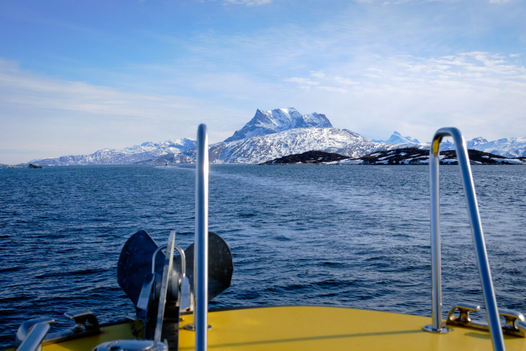 View from the front of the boat heading towards Sermitsiaq mountain on a boat tour to the Nuuk Icefjord with Guide to Greenland