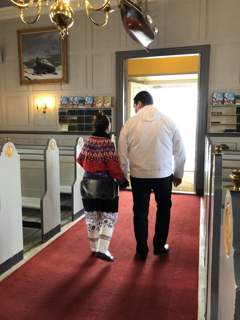 Couple leaving church after getting married in Greenland