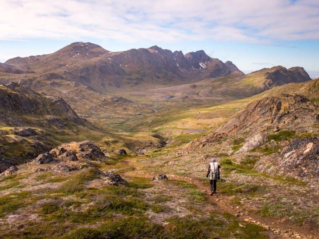 Man walking along the last stretch of the Arctic Circle Trail near Sisimiut