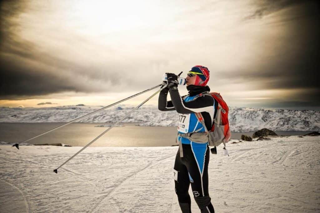 Man taking a sip of water during Arctic Circle Race
