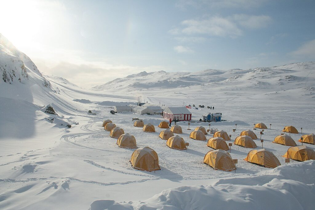 Yellow tent camp on the trail of Arctic Circle Race