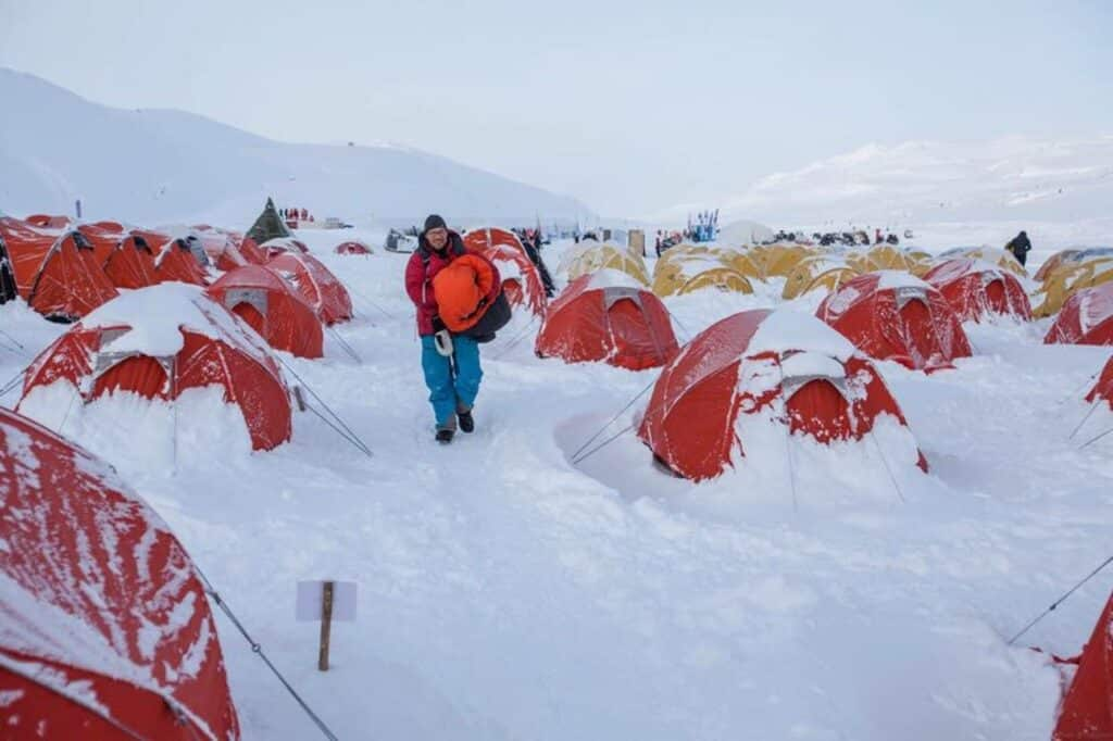 A man finding his way through the red and yellow tents
