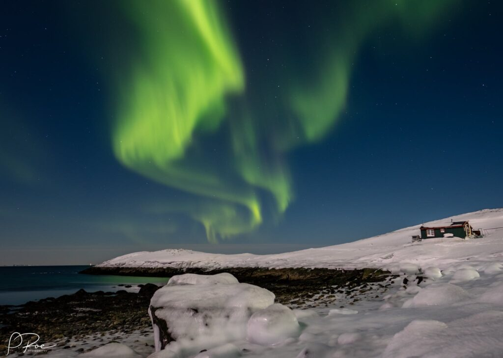 Northern lights over the beach