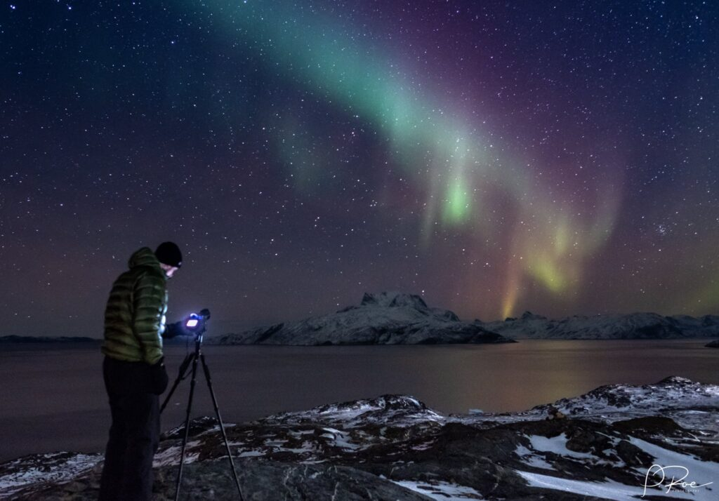 Man taking a picture of the northern lights