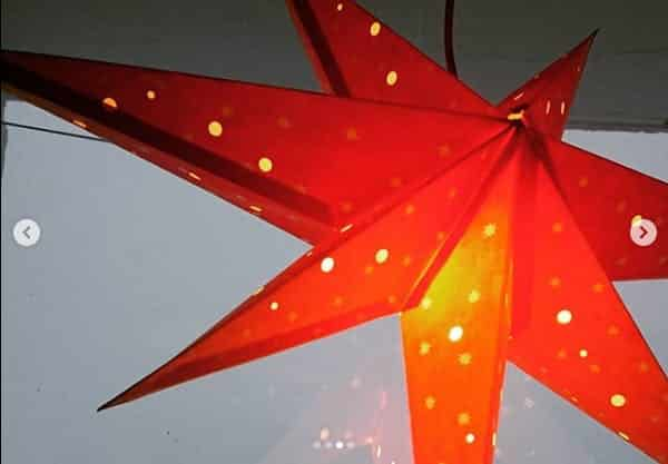 Red christmas star in window