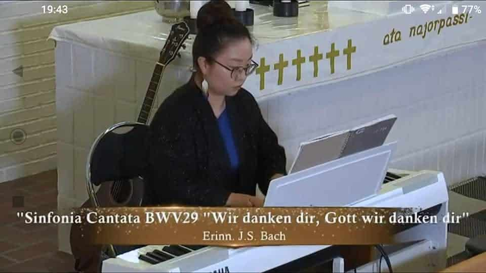 Woman playing the piano in church