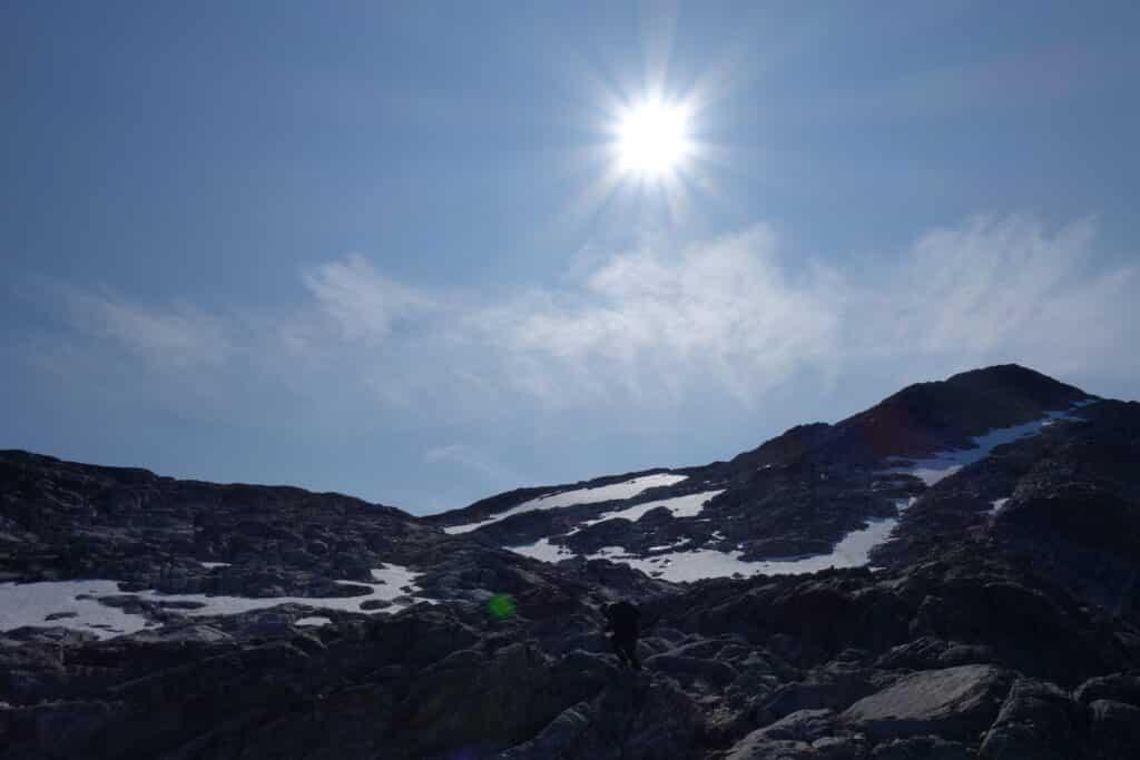 Sun shining and snowy mountain