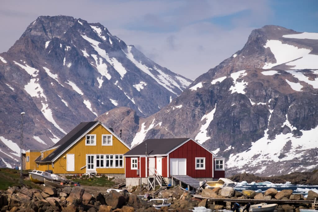 Colorful houses with impressive views of the mountains in Kulusuk in East Greenland