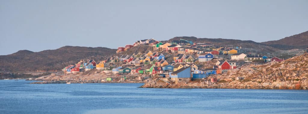 Colorful houses of Aasiaat line the shores of Disko Bay