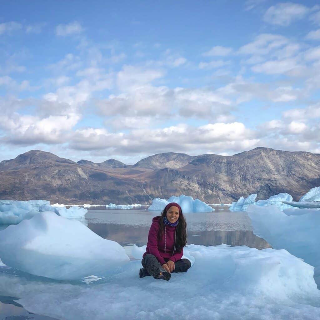 Girl sitting on iceberg