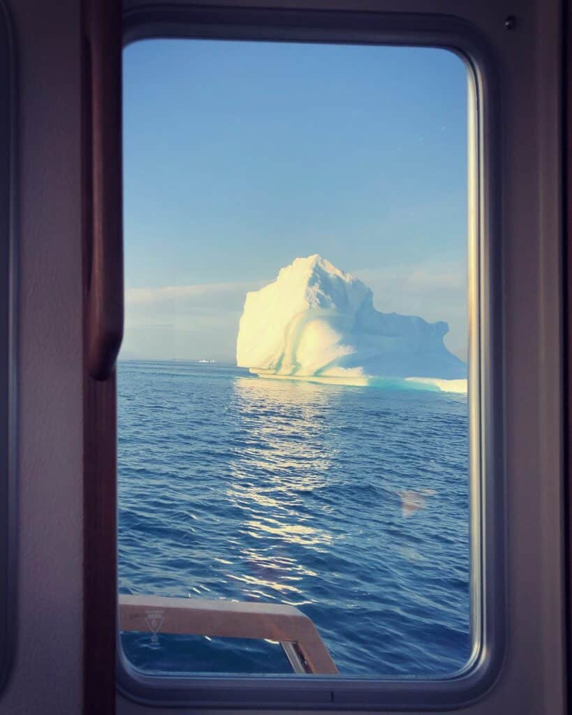 Iceberg in water seen from a boat