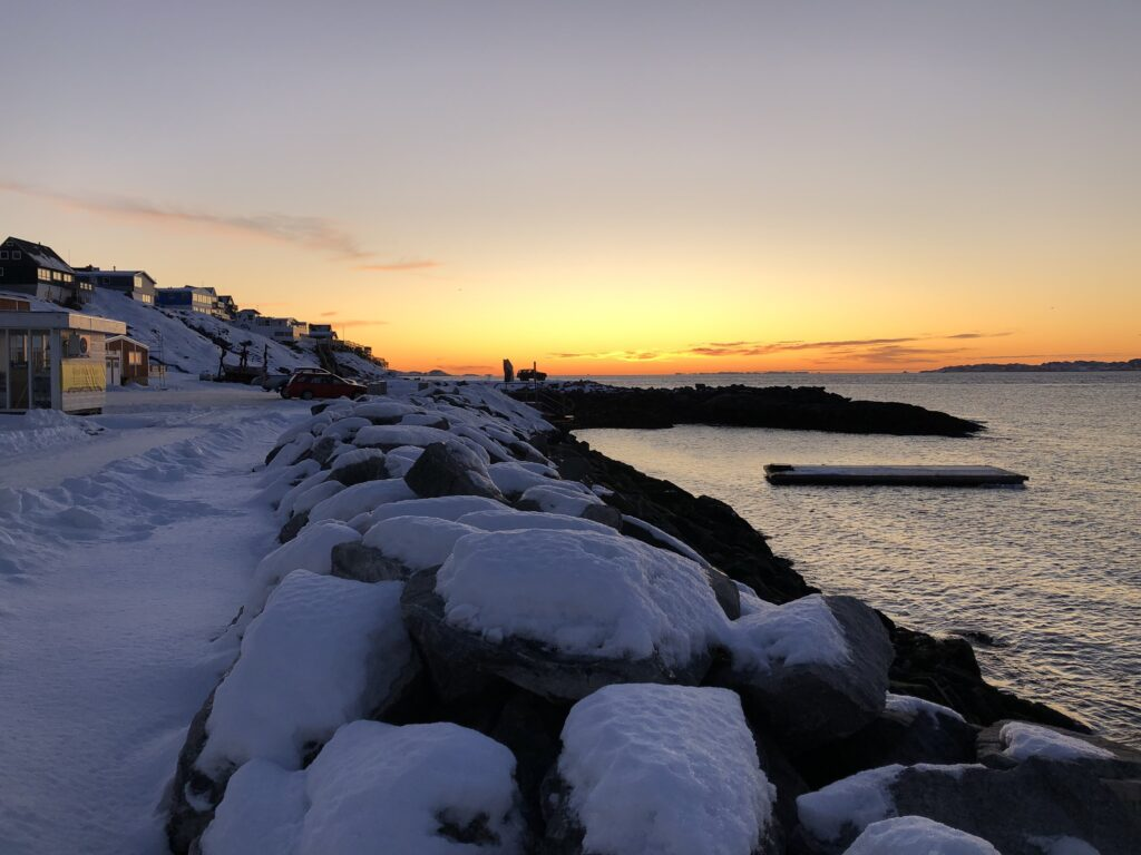 Nuuk in winter with a orange sunset