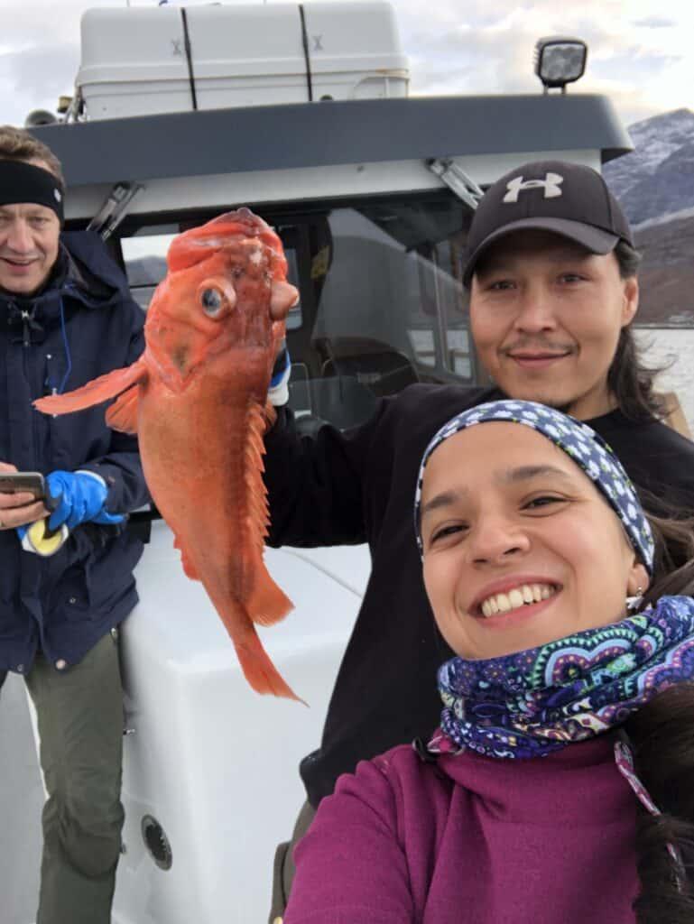 Three people one fish