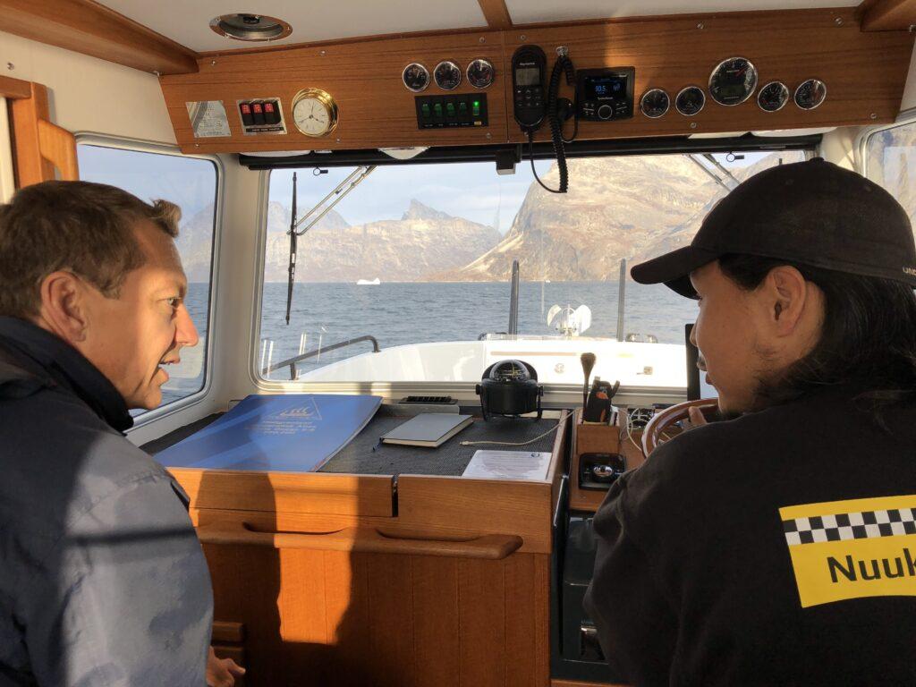 Passenger and captain talking