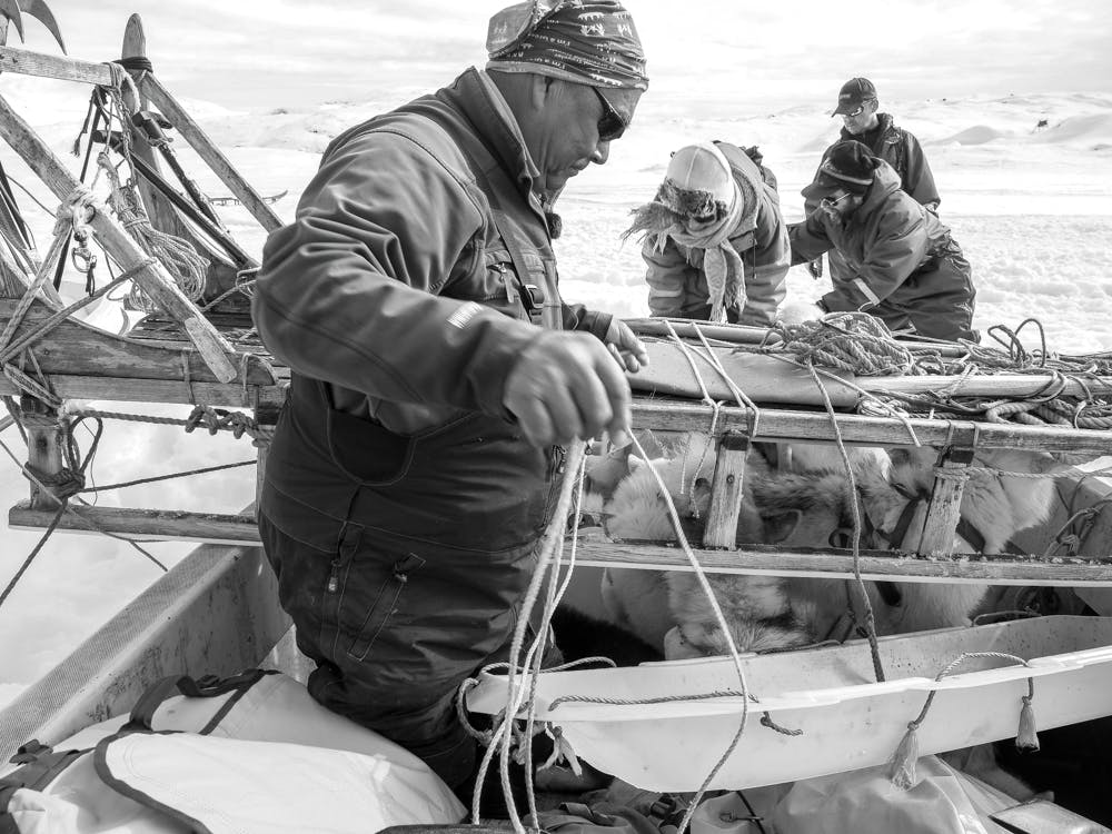 Securing the dog sled to the boat