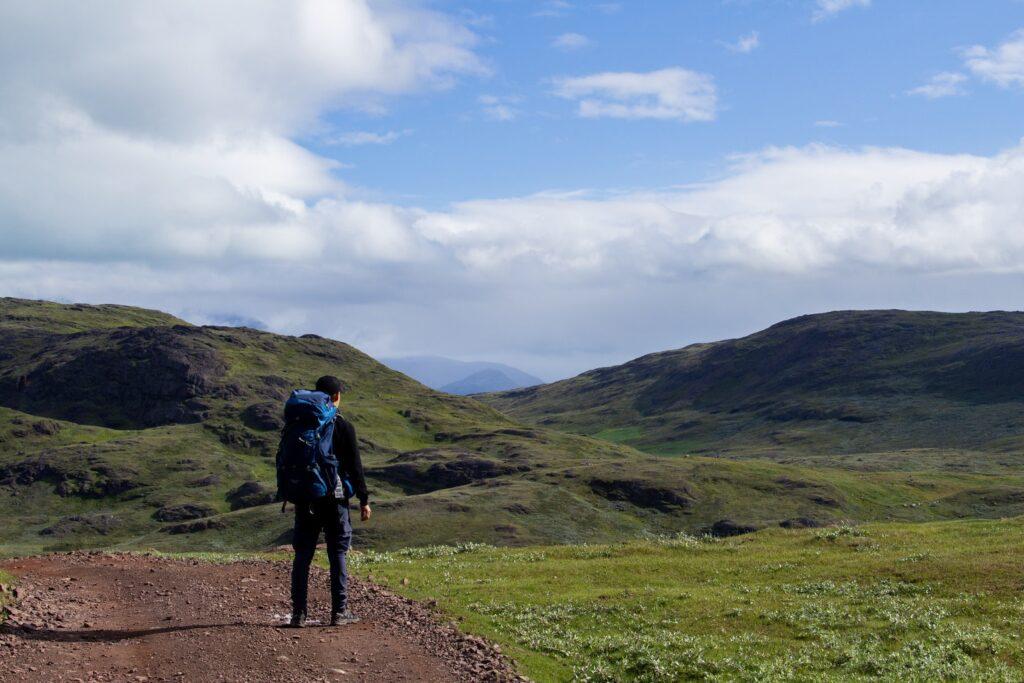 Man wearing a backpack enjoying the view