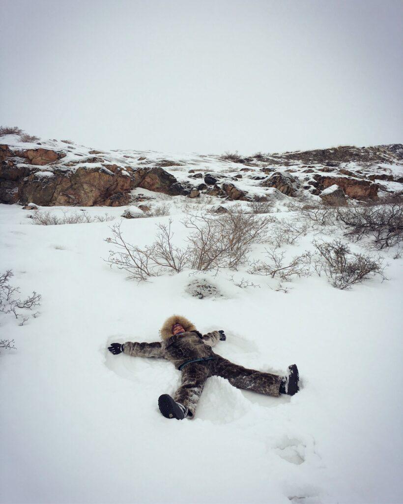 Girl making a snow angle