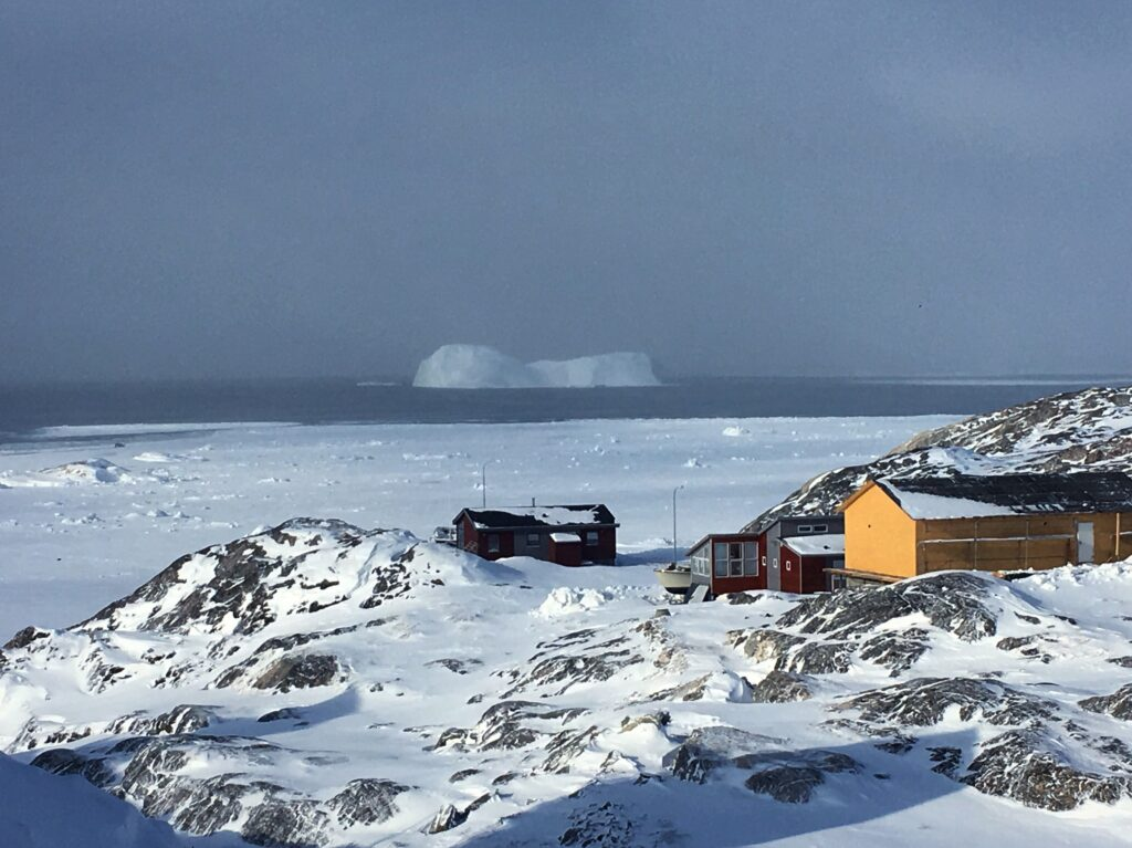 Houses with iceberg in the back