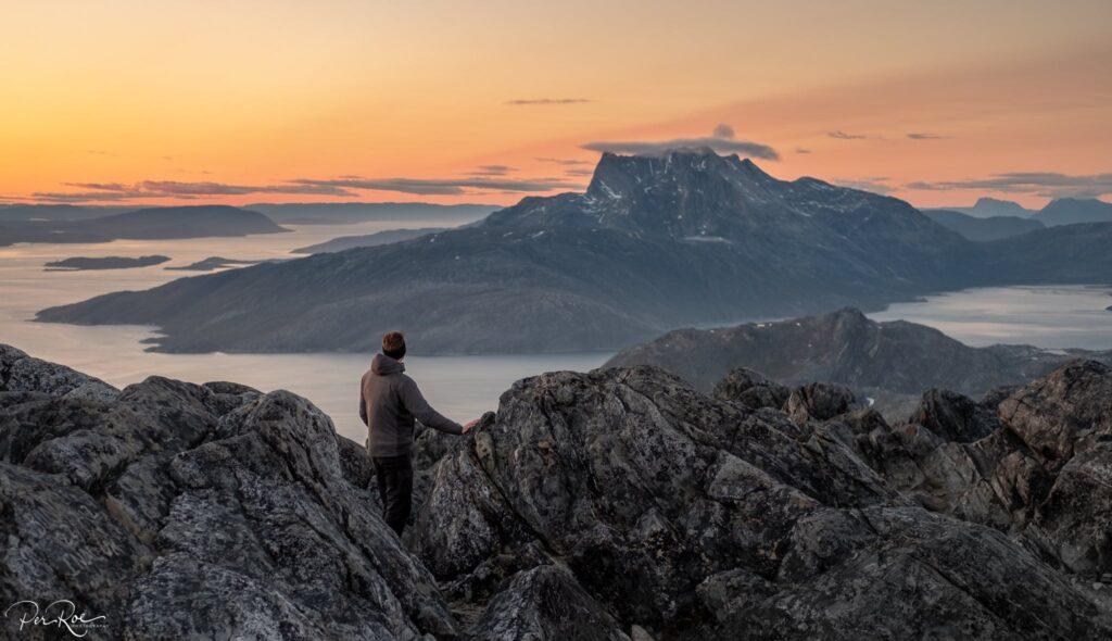 Man looking towards Sermitsiaq mountain in Nuuk