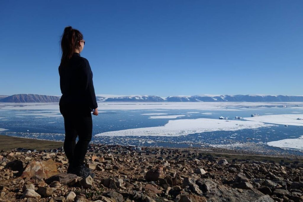 Woman enjoying the view of the icefjord