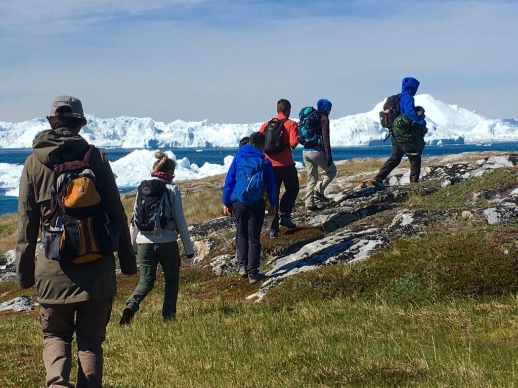 People hiking to Sermermiut