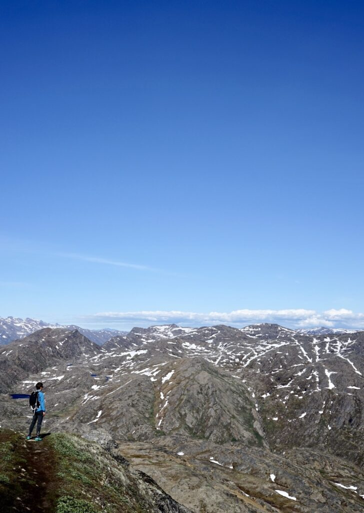 Man looking towards snowy mountain tops