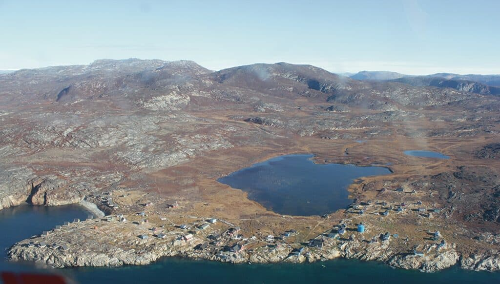 Flying over a small settlement in Greenland