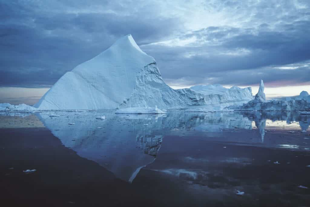A large iceberg in the water surrounding Ilulissat