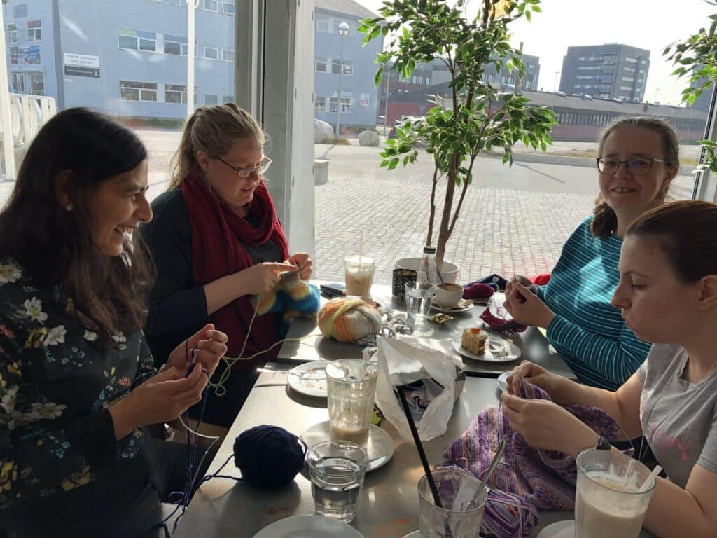 Four women knitting together at a cafe in Nuuk