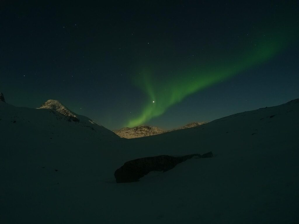 Northern lights over a mountain top