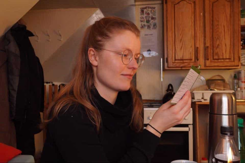 A woman reading something from a board game