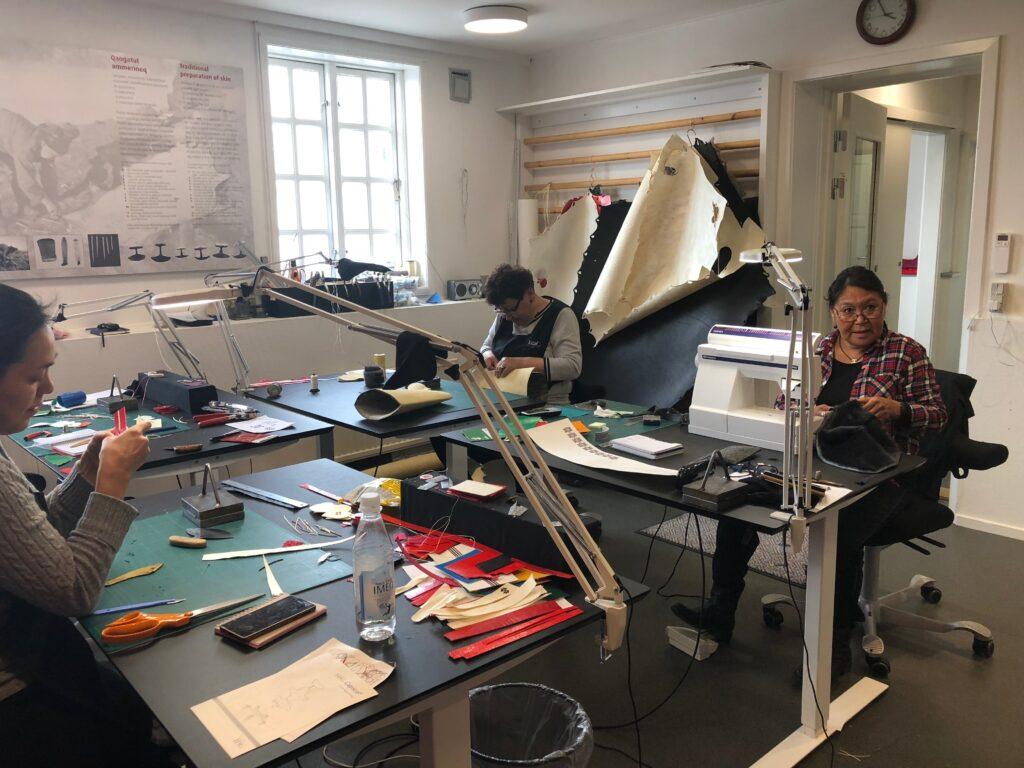 Artisans making national costumes