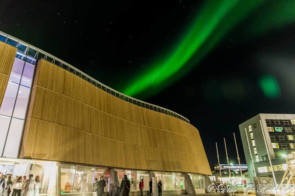 Northern lights above Greenlands Cultural House Katuaq in downtown Nuuk