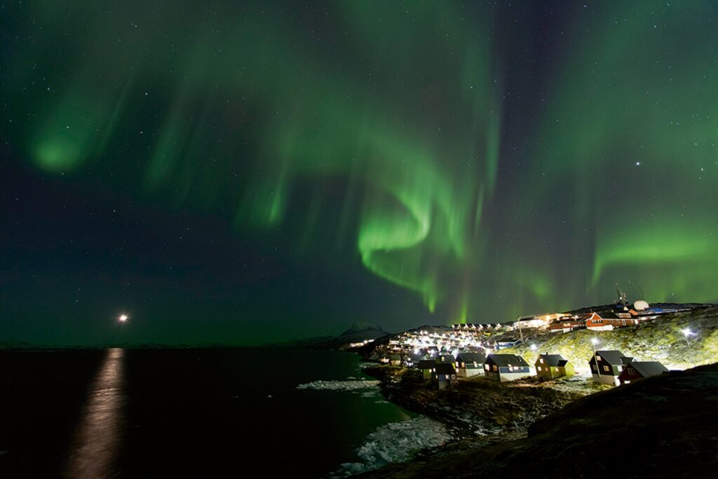 Beautiful northern lights over houses in Greenland