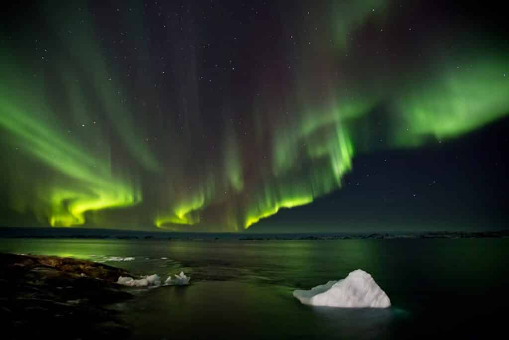 Northern lights over chunks of ice in Greenland