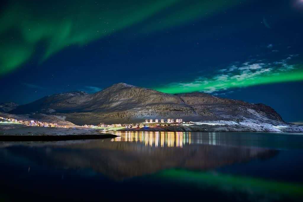 Northern lights over Store Malene and the suburb of Qinngorput in Nuuk