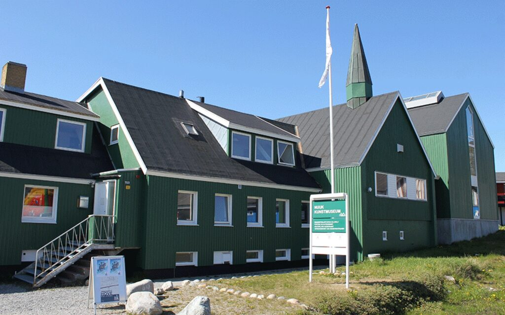 The green facade of the old church that now is Nuuk Art Museum