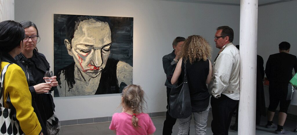Art work presented in Nuuk Art Museum, a beaten woman bleeding from her eyes and nose