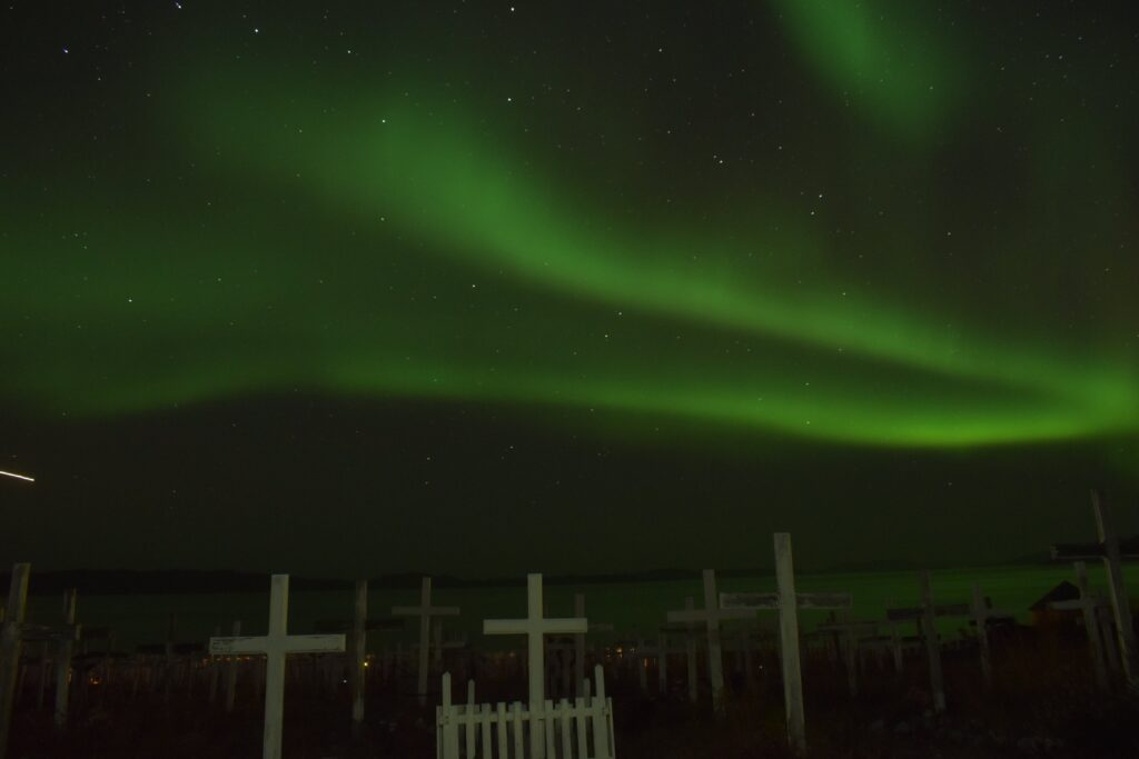 Northern lights over a cemetery in Nuuk, capital of Greenland