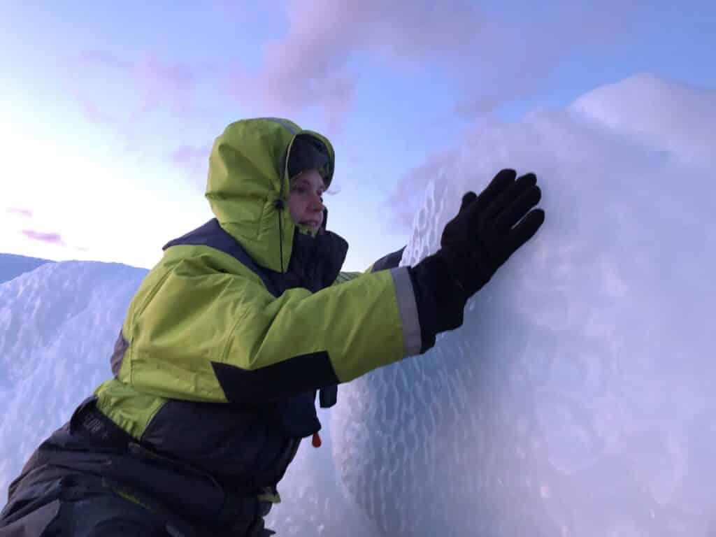 Woman touching an iceberg